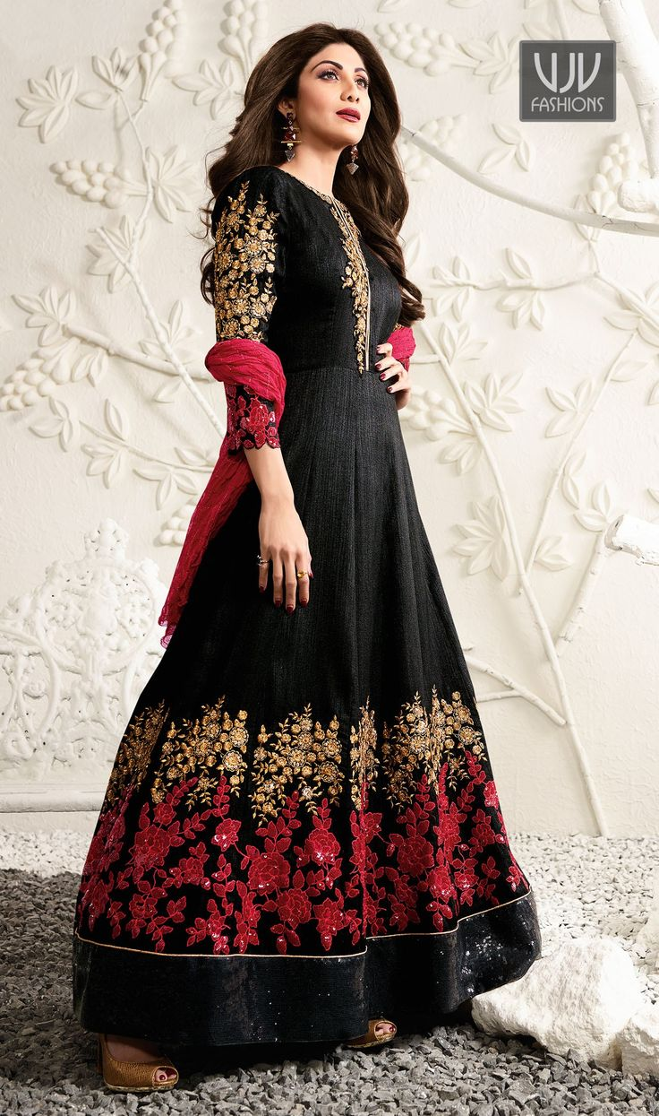 Shilpa Shetty Black Color Raw Silk Designer Anarkali Suit  Be your distinct style diva with this Shilpa Shetty black color raw silk designer anarkali salwar suit. The gorgeous embroidered and resham work through the attire is awe inspiring.