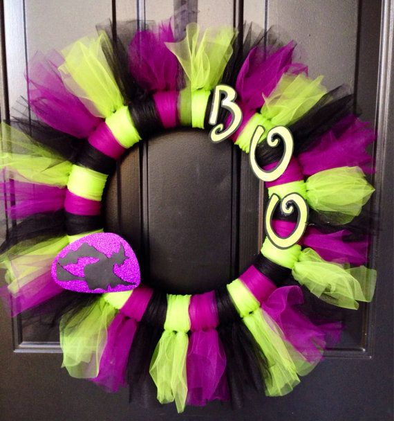 Halloween themed wreath made with purple, black and line green tulle. Sits on a 14 in foam wreath base with spooky witch and BOO to make this