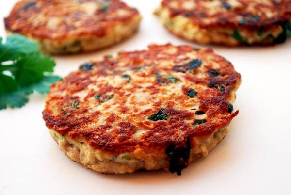 Tuna Cakes 2 (4oz) cans tuna in water, well-drained in a colander (press on the tuna to extract water) 1/2 cup quick-cooking oats 2 large eggs 1/2 cup plain low fat Greek yogurt (Voskos is the creamiest) 1/2 teaspoon salt 1/4 teaspoon black pepper 1/2 cup chopped fresh parsley 2 tablespoons olive oil for frying