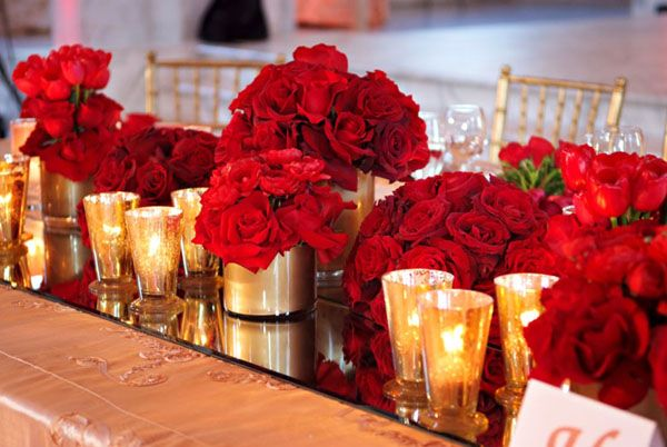 Red rose table centerpiece for wedding gold accents
