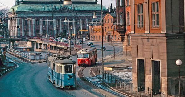 Bus and tram on Munkbron in Stockholm 1964 by Stockholm Transport Museum Commons