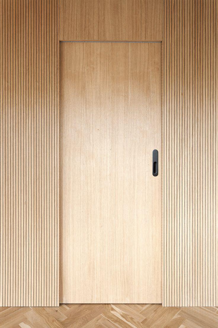 Material combinations and minimal details enrich a Prague apartment