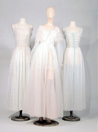 Group of Schiaparelli Nightwear, French, 1950s. White nylon, comprising a nightgown with pale blue velvet straps and smocked bodice, a Schiffli embroidered nightgown, and a peignoir set with pastel pink bodice and skirt underlayer, each labeled: Schiaparelli/Paris/New York.