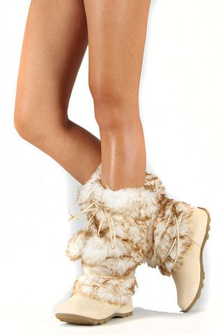 Keep warm and look stylish on a cold winder day with this eskimo mid calf boot. Featured round toe and furry boot construction with criss cross strap decor and self bow tie pom pom strap. Soft interior for all day wear.