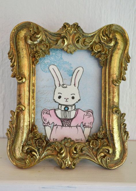 Sweet lady bunny in a golden frame.