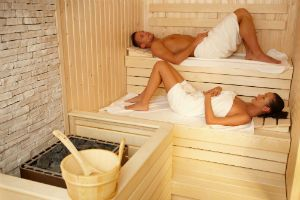 5 Health Benefits of Sauna Use - Sweating is a form of detoxification and there may be no better place to stimulate this process than in the sauna. Sauna therapy developed in the Scandinavian region, specifically Finland, and is used for bathing, improving ailments, and even as a setting for childbirth. It's no wonder, more than just a place to feel good, the sweat inducing heat is also thought to improve many health problems including hypertension, fatigue, pain, and even addiction.