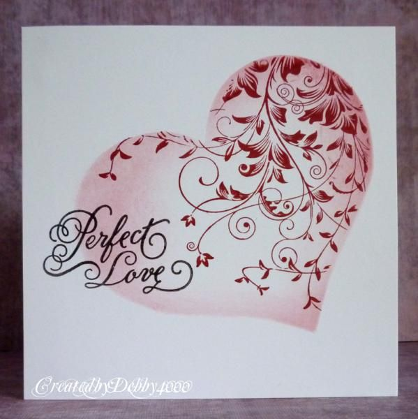 "By Debby4000 at Splitcoaststampers. Cut or die cut a large heart. Use the negative cut as a mask. Stamp Hero Arts ""Leafy Vines""; then sponge inside the heart near the edges. Add sentiment."