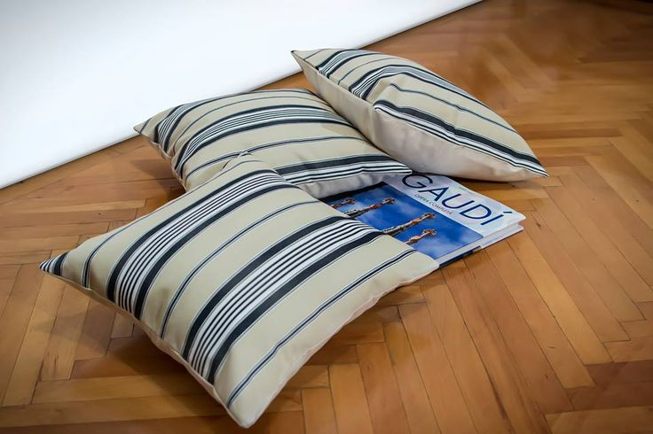 Handmade throw pillows. Creamy and marine blue stripes on one side and creamy on the other. Materials: Creton, Pillow inserts included. Made to order.