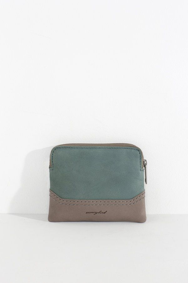 Super handy purse with a big top opening for ease of use. Ideal for carrying excess change or cards  soft drum dyed cow leather top zip closure 100%...