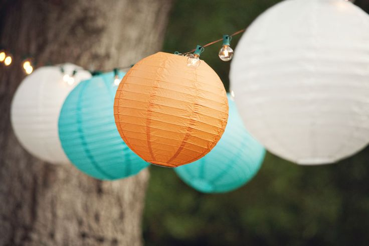 Tangerine and Teal...inexpensive pops of color for any outdoor wedding.