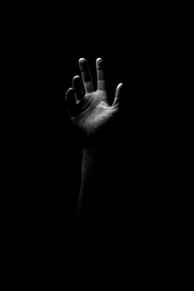 Reaching out from within the darkness. Never give up hope for the light just beyond your reach.