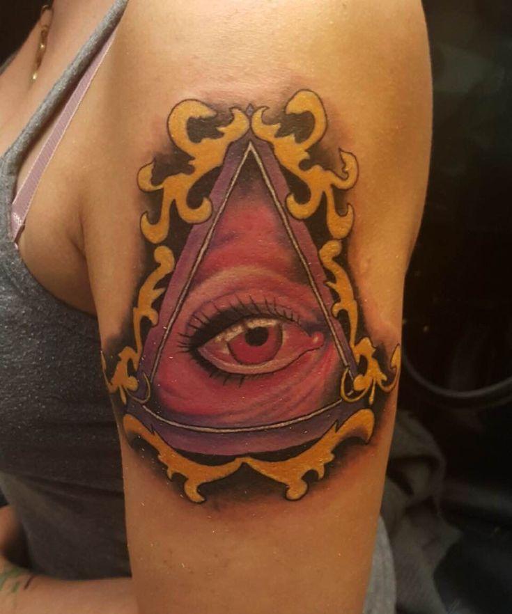 Framed eyeball tattoo evolution ink studio