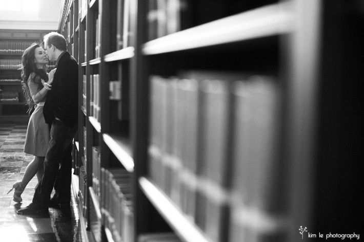 LOVE IN THE LIBRARY engagement photo. No need for sexiness, but I like this angle. Maybe have the couple a little closer for a shareable photo in invitations.