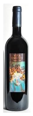 """Viña Urbezo Vintage 2011  Tasting: Intense cherry red colour with violet and purple highlights. Aromas of red and black fruits ,raspberries, blackberries, cherries and plums. Fresh wild flowers notes with a touch of balsamic herbs and liquorice. Smooth entry and very pleasant in the mouth. Good structured, velvety and wonderfully balanced.     Serving suggestions: Spanish rice and """"fideuá"""", mushrooms, foie gras, red meat, roasts, cheese and seasoned fish."""