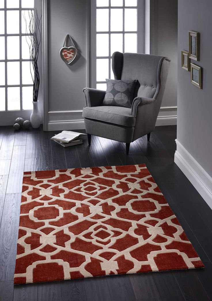 Designer Rugs for a perfect modern day décor. #designerrugs #terracottarugs #orangerugs #largerugs #handtuftedrugs #modernrugs #acrylicrugs