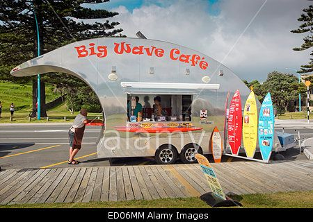Big Wave cafe with surfboard menu signs, parked at Mount Maunganui beach, New Zealand