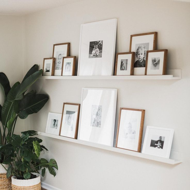 One Of My Favorite Parts About Our Home My Two 8 Ft Gallery Wall Shelves Filled In 2020 Gallery Wall Shelves Gallery Shelves Gallery Wall