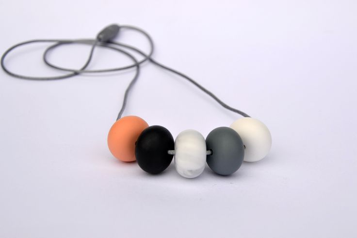 Part of the Abacus range, a longer style with beads that move freely on a 85cm grey cord with a silver safety clasp. Nordic: Peach, Black, Marble, Grey