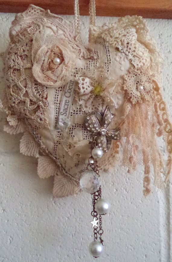 I made this with all sorts of lace, flowers,scrim,beads and a fun tassel  has a hanger and a brief poem on the back  Long frays on one side.  This