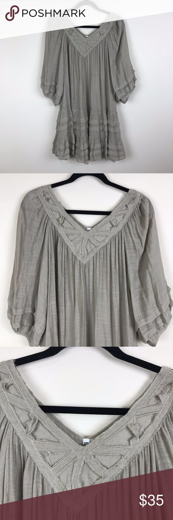 NWOT MONO RENO LARGE BOHO DRESS GORGEOUS FUN BOHO DRESS BY MONO RENO. LARGE. RUFFLE HEM AND SLEEVES. BELL SLEVES. V NECK WITH CUT OUT DESIGN FRONT AND BACK. SO FLIRTY AND FUN. NEVER WORN. UNIQUE NEUTRAL GREY COLOR. HIPPIE,BOHO,GYPSY,FESTIVAL,URBAN OUTFITTERS,FREE PEOPLE G MONO RENO Dresses Mini