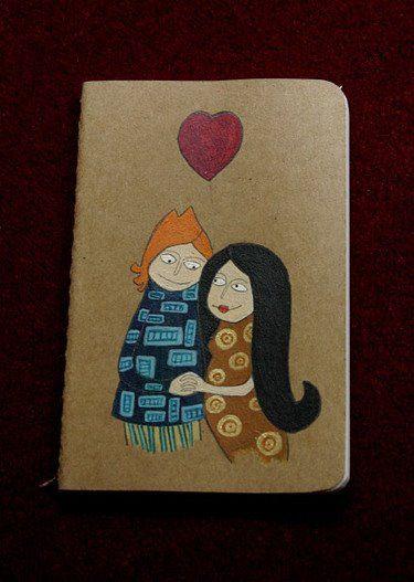 Amoureux sur un carnet, carton souple, acrylique vinylique et encre de chine, 2010 © Astrid Genette