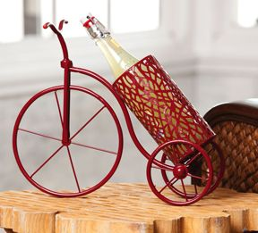 """Red Bicycle Wine Holder for $48.95 from WineRacks.com  Why would you ever merely present your wine on the countertop, when you could give it its own bicycle to ride in? For anyone with a love of the wind in their face, a desire to let go of the handlebars, or the memory a favorite childhood bicycle, this is a home accent made just for you. It's perfect for you or as a unique gift idea.   12"""" L x 6.5"""" W x 15.5"""" H"""