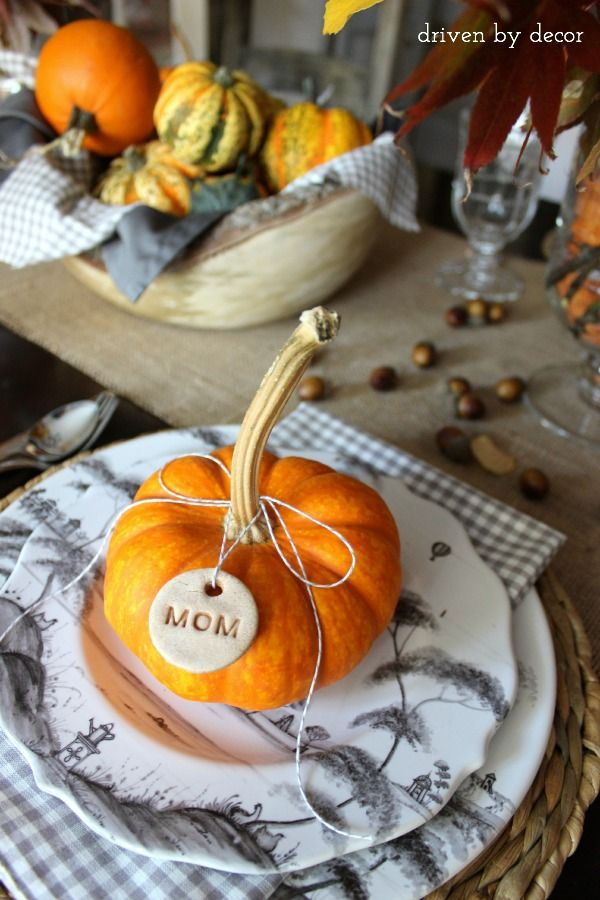 Thanksgiving table with easy to make salt dough name tags tied on mini pumpkins for place cards