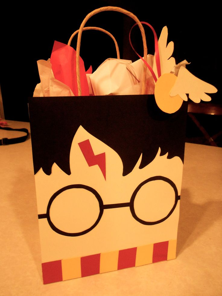 Cause I know he'll never go on pinterest... I made a Harry Potter gift bag w/ Golden Snitch gift tag for his VDay present #Pinspired