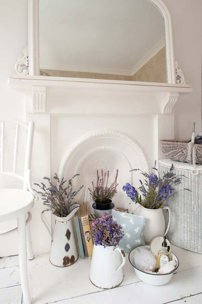 White fireplace with lavender