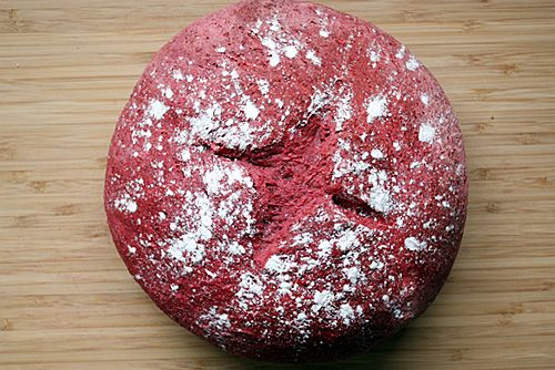 Beet Bread   Ingredients:  3/4 cup warm water  1 1/2 cups raw beet puree (about 2 1/2 peeled medium beets)*  3 1/2 to 4 1/2 cups unbleached all-purpose flour  2 tbsp olive oil  2 tsp salt  1 tsp sugar  2 1/4 tsp active dry yeast    ***Follow the link for further instructions.