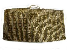 Pathway: This kete whakairo was gifted to the Auckland Museum in 1875. It featured in the 1977 Auckland Museum exhibition, 'Baskets of the Pacific'.        Catalogue description: This kete features a diamond pattern in dyed brown and undyed harakeke. The plaited muka is attached around the top edge to form the handles.