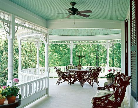 Camp Boxwoods' Queen Anne Victorian style begins at the circular front porch—the first project pursued by the owners when the rest of the house remained bland, single-story 1979 ranch-style architecture. The porch throws curves to augment the original straight lines and packs in gingerbread trim to reinvent the house as Victorian. Sources: Furniture: Boxwoods Gardens and Gifts, 404/233-3400.
