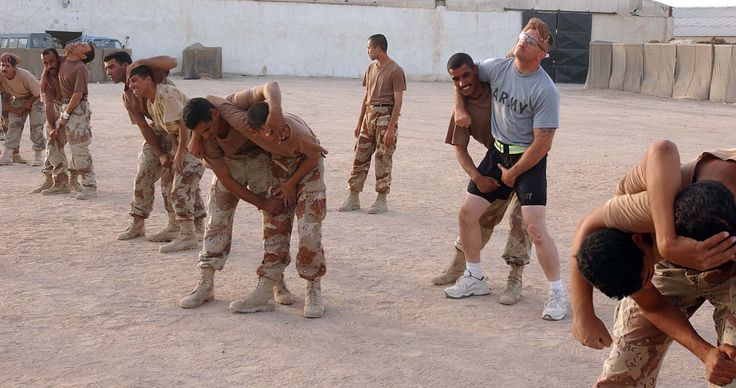 US Army soldier protects himself during combat training with Iraqi Army recruits 2007 [2000 x 1056]