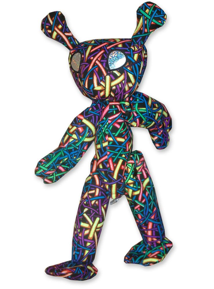Space Tribe Alien ! Approximately 40 cm tall. UV Active ! Movable arms & legs. Holographic plastic eyes. 100% cotton with Dacron filling.