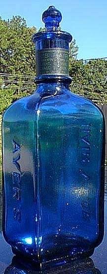 blue glass hair bottle