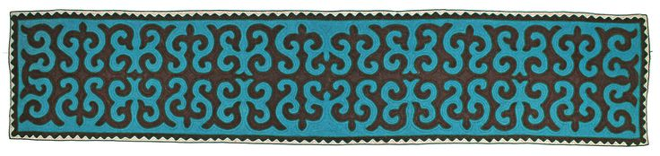 Shyrdak runner rug from Felt in bright blue, black and white, with a green trim 0.8m x 3.85m feltrugs.co.uk