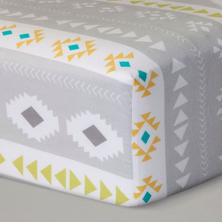 "You don't need to go on a pilgrimage through the desert to enjoy this Yellow and Gray Desert Dreams Fitted Crib Sheet from Cloud Island™. The unmistakable designs of the desert are boldly printed on this fitted sheet. Give your baby room a southwestern flair without being overbearing. Light gray and yellow hues are calming, ideal for not taking away from the rest of your decor.<br><br>Sleep Safely, Little One<br>When putting baby to sleep, ""Bare is Bes..."