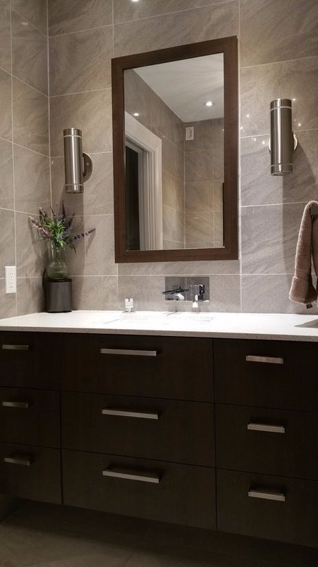 Take your bathroom to another level with ceramic tiled walls and dark cabinets. Jazz up your bathroom with more design ideas with SCD Design & Construction!