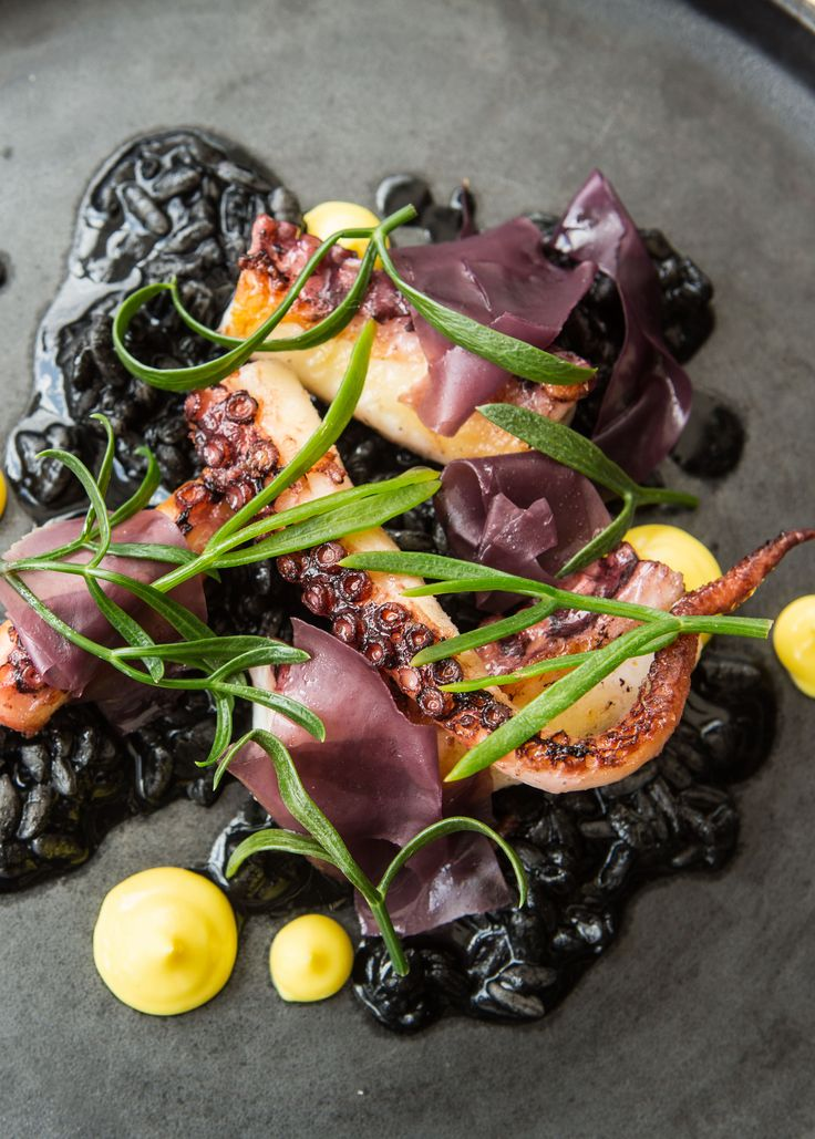 Octopus, 'black rice', saffron by Paul Welburn