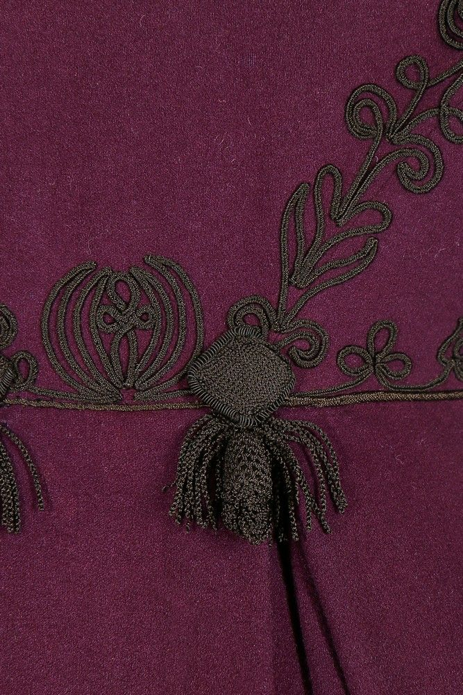 A rare purple wool pelisse robe, 1810-20. with puffed mancherons over long sleeves, raised waistline and curved collar, adorned with couched black braid, tassels to rear waist, part-lined in silk, with inner ribbon waist ties, hooks and eyes to front closure. Kerry Taylor Auctions