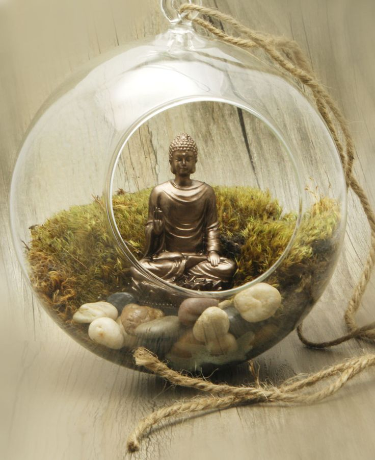 The hanging globe terrarium houses both a mediating Buddha statue and live moss that inspire calm within the home and soul.