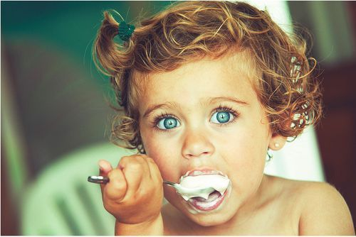 This just makes me happy. children. beautiful eyes. curls. ice cream. enjoying the little things in life.
