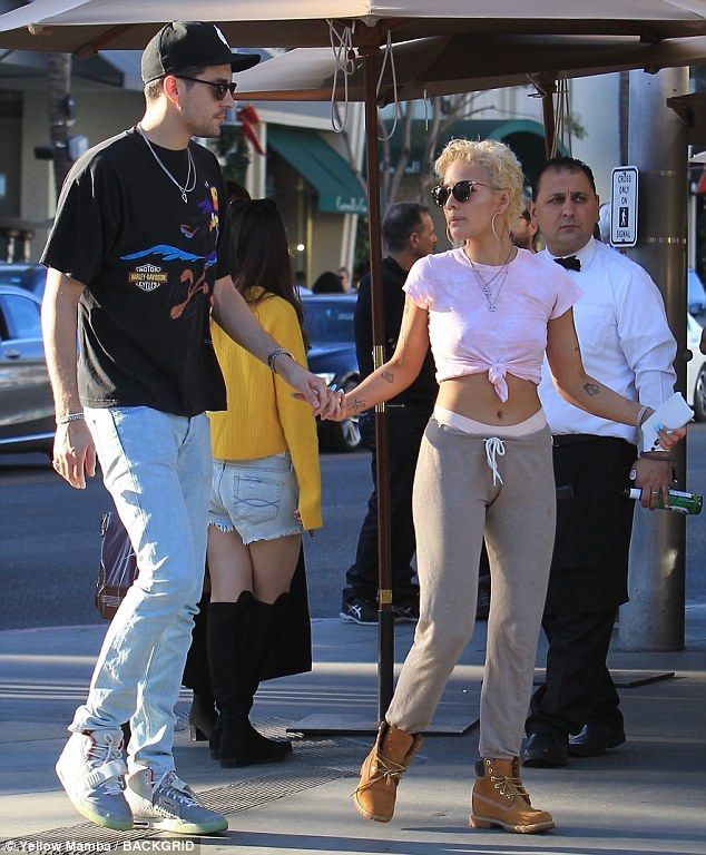 The Bad At Love songstress teamed her casual look with tan Timberland boots...