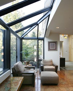 Glass alcove for intimate conversation or reading - stained concrete floor | Castanes Architects PS