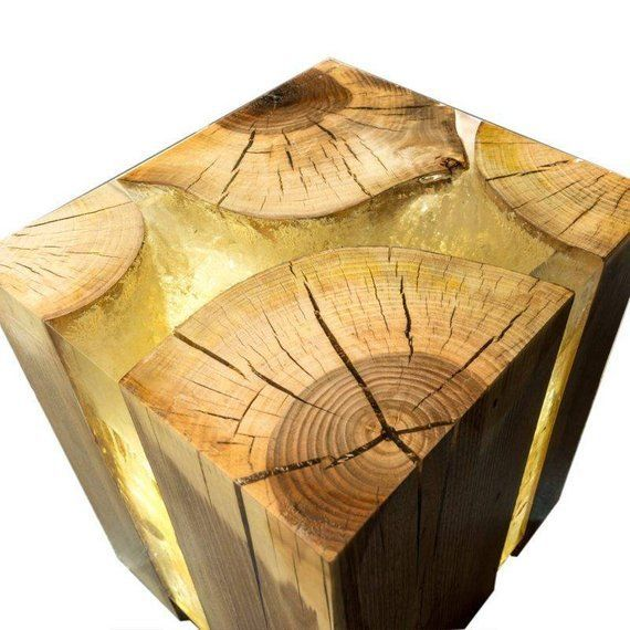 Designer table made from walnut wood and resin