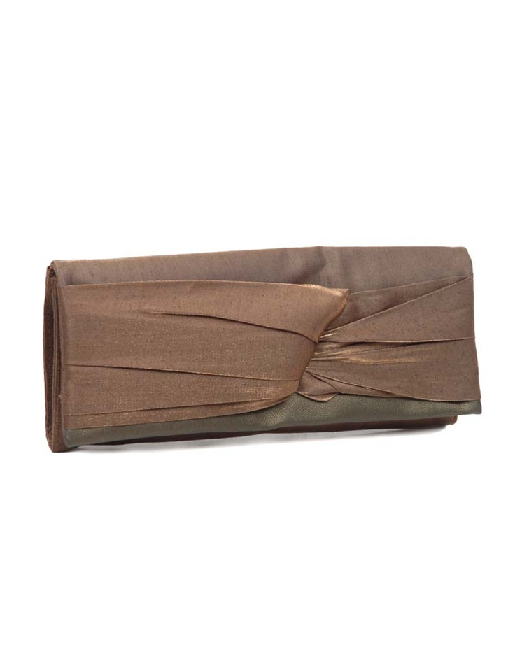 Jazz up your cocktail parties with this brown clutch from Baggit.
