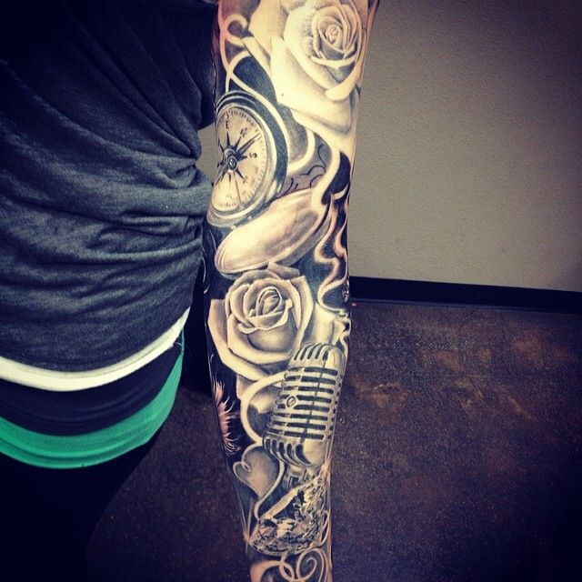Sleeve tattoo. Rose, microphone, compass