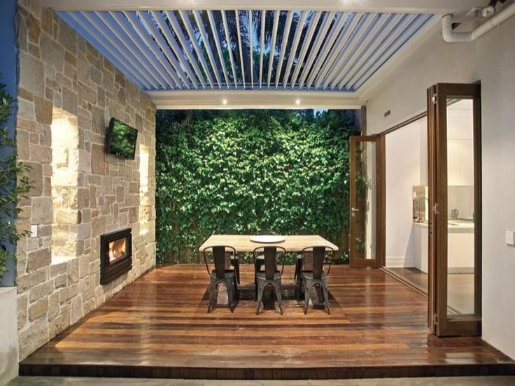 Outdoor fireplace green wall and vergola love it toorak for Outdoor kitchen wall ideas