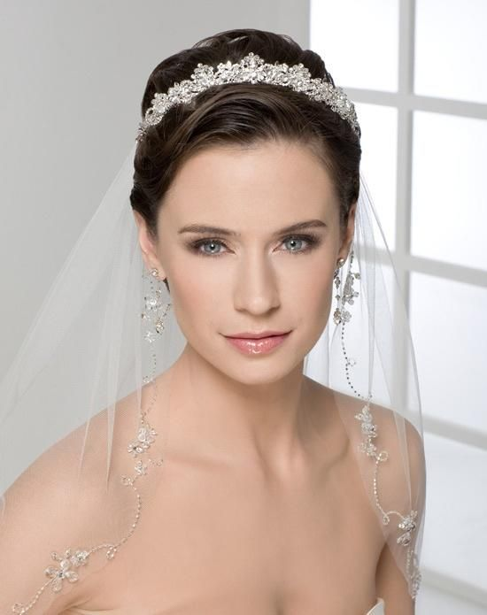 Dainty and Beautiful Crystal Trimmed Wedding Veil with Amazing Crystal Headband Tiara. See more like this....