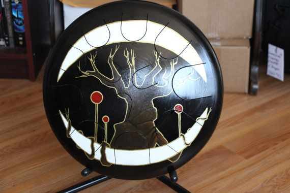 Introducing the Ajna Drum! Comparable to Handpans and other steel drums this 16 drum has 12 notes and is tuned to a Phrygian Scale with an E root. The pitch set for this particular drum is E F G A B C D E F G A B  Original artwork by the wonderfully talented Dragon Bunny. Piece entitled Pretentious Naked Cold Season Tree on Top of Heretical Marshmallow Moon.  Check it out! The drum for sale in this listing is being played here: https://www.youtube.com/watch?v=yAXYAB7BMe4  All Ajna drums are…